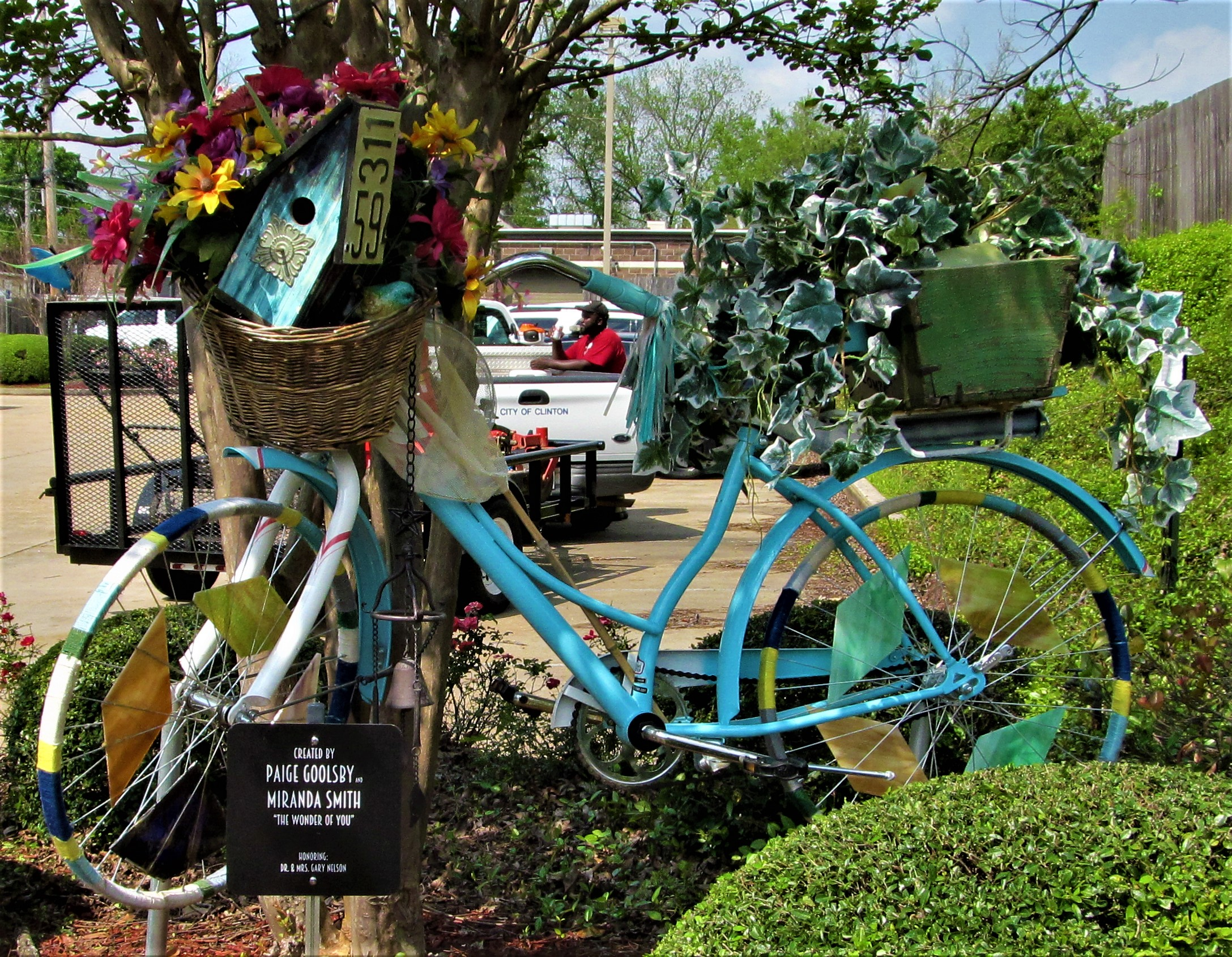 lawn guy blue bicycle clinton